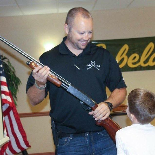 Explaining how a pump-action shotgun works.